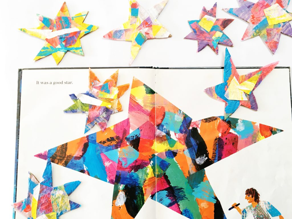 "This Eric Carle craft was inspired by his gorgeous book ""Draw Me a Star."" We painted tissue paper and then created paper stars to make a wall hanging."