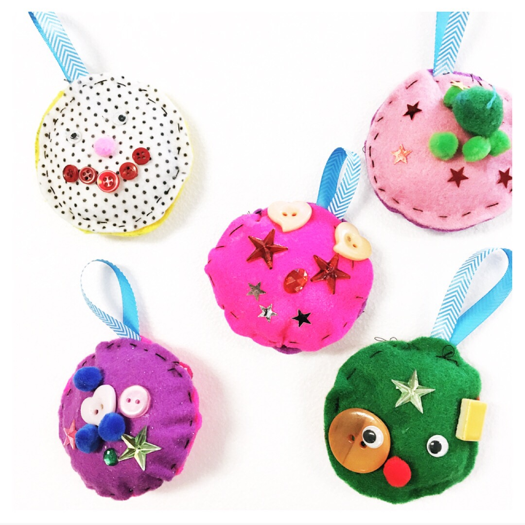 These kid-made felt Christmas baubles are simple to make, use basic sewing skills and are perfect for adding a handmade touch to your tree. #Christmasornaments #kidmade #Christmascraftsforkids #kidsChristmasornaments #Christmascraft #sewingforkids