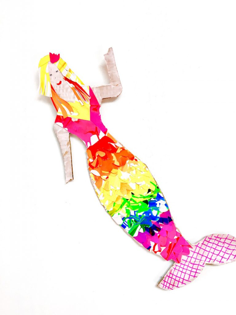 Are mermaids all the rage at your place right now? Grab your free printable to make your own rainbow mermaid out of cardboard and salad spinner art.