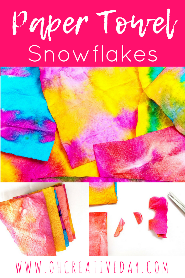A simple art and craft project for kids involving paper towel and food colouring to create cut out snowflakes.