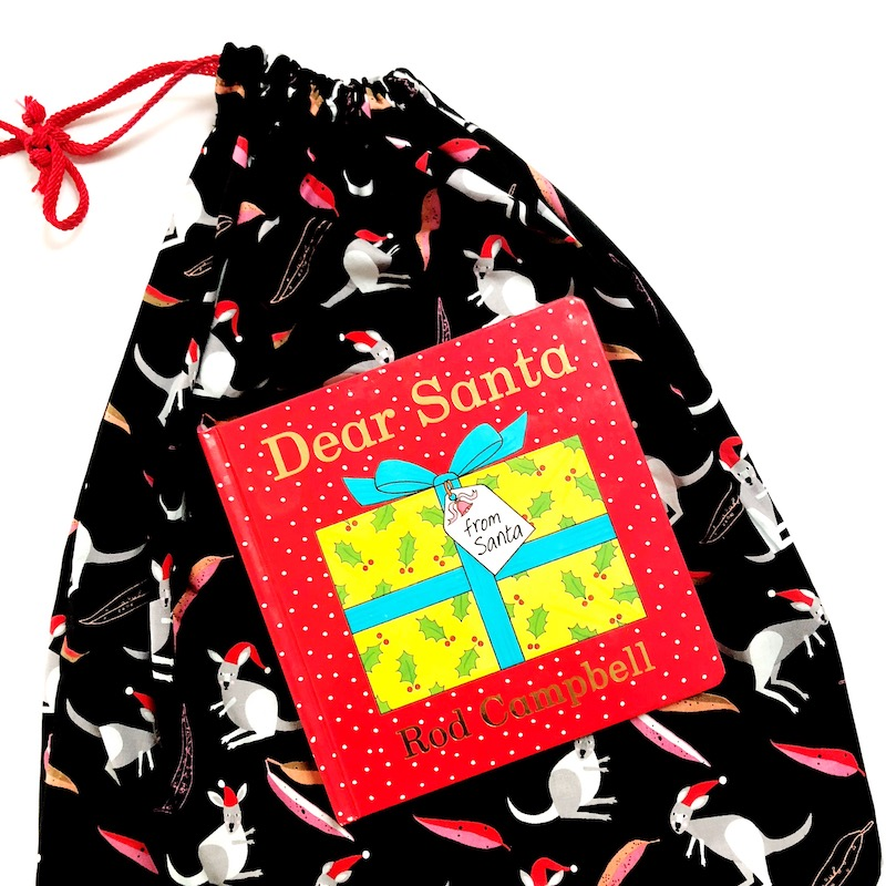 Every festive season, we countdown with a Christmas Book Advent. 24 books that take through until Christmas Day. This year, I've hand-sewn these keepsake book bags. Each day, I will simply place a new book in each child's book bag. This is a simple sewing project for even the not-so-confident seamstress. #Christmasadvent #ChristmasDIY #Christmascrafts #Christmasbookadvent #kidscrafts #Christmasforkids